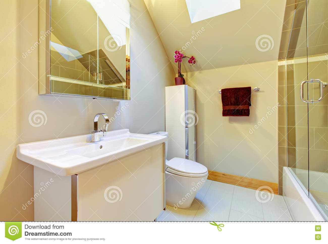 Small Beige Bathroom With Shower Toilet And Vaulted Ceiling