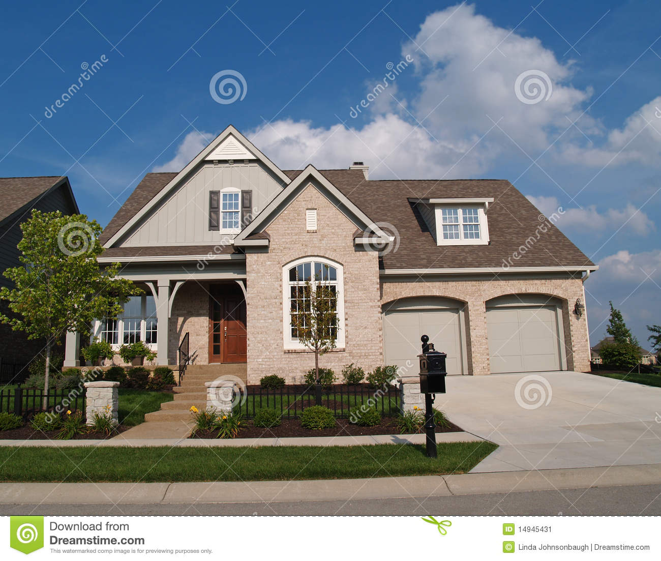 Small beige brick home with two car garage in fron stock for Small two car garage
