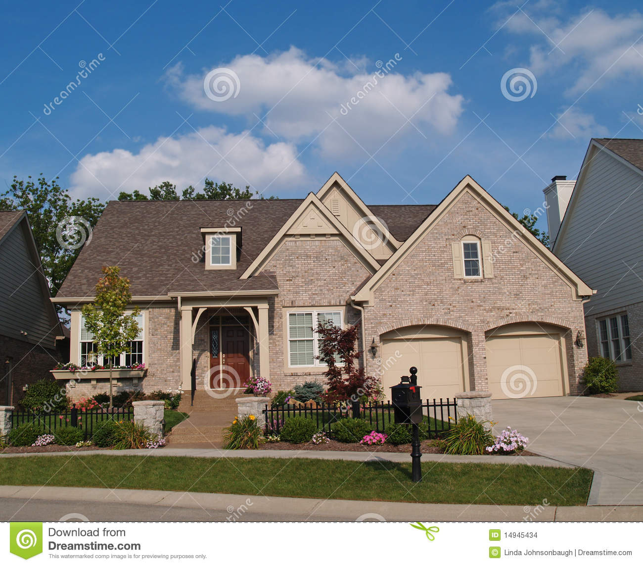 Small Beige Brick Home Two Car Garage Fron on 3 car dormer garage plans