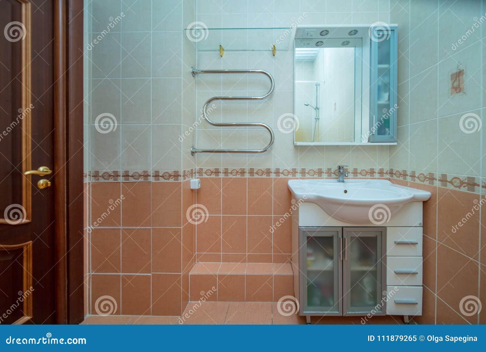 Small beige bathroom