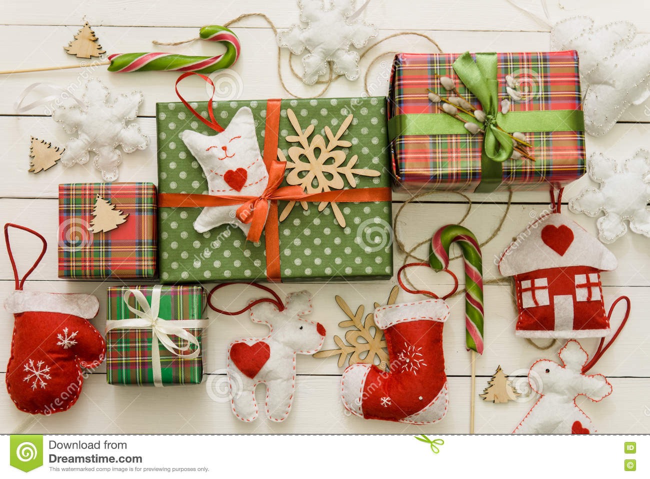 Small And Big Christmas Gift Boxes On Wood Background Stock Image