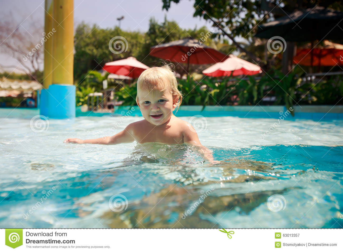 Small Blonde Girl Plays Smiles In Transparent Water Of Pool Stock Photo Image 63013357