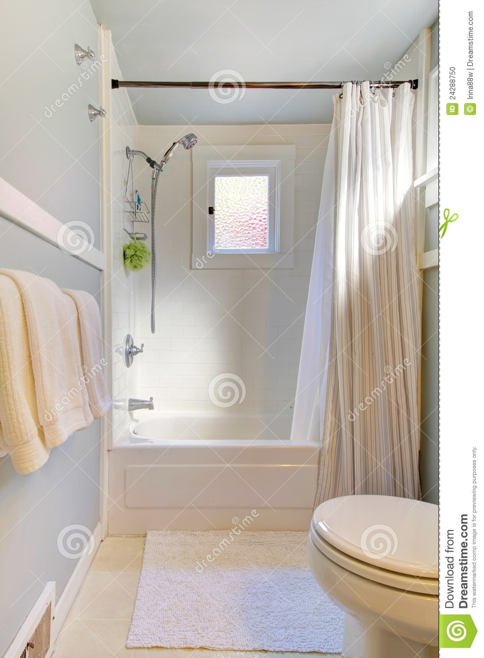 Small blue bathroom with light grey blue stock photo for Petite salle de bain agencement