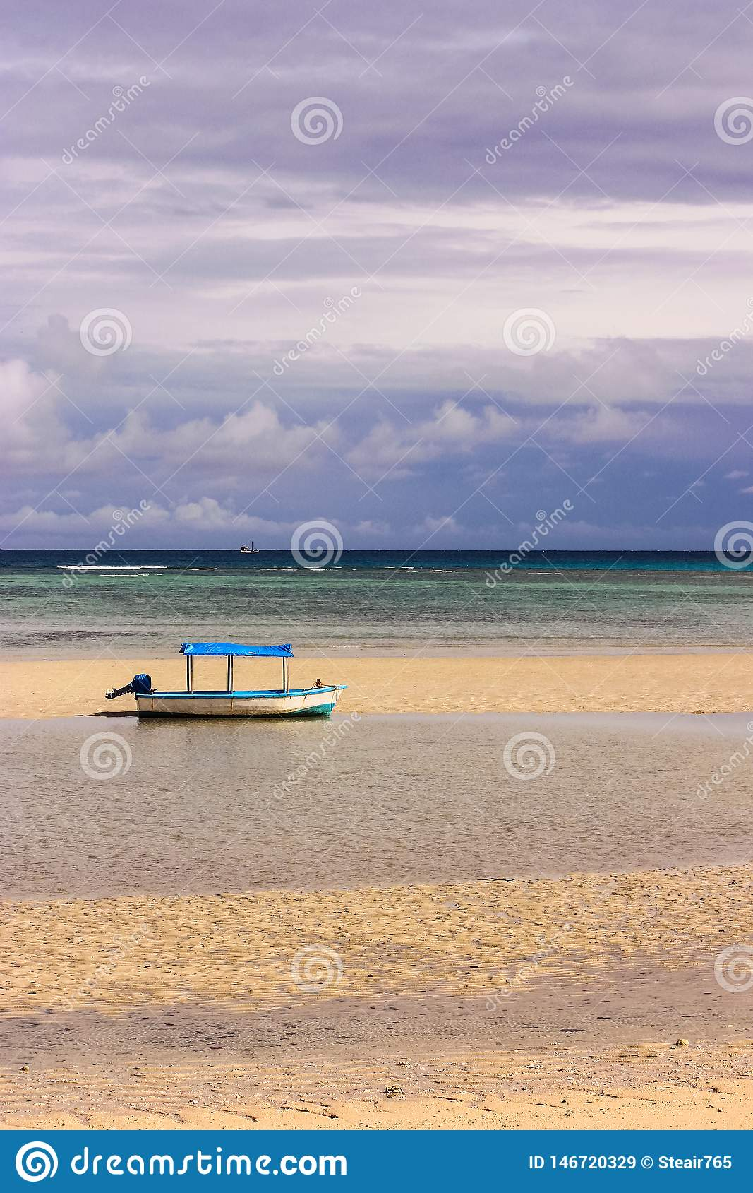Boat with canopy  on the beach
