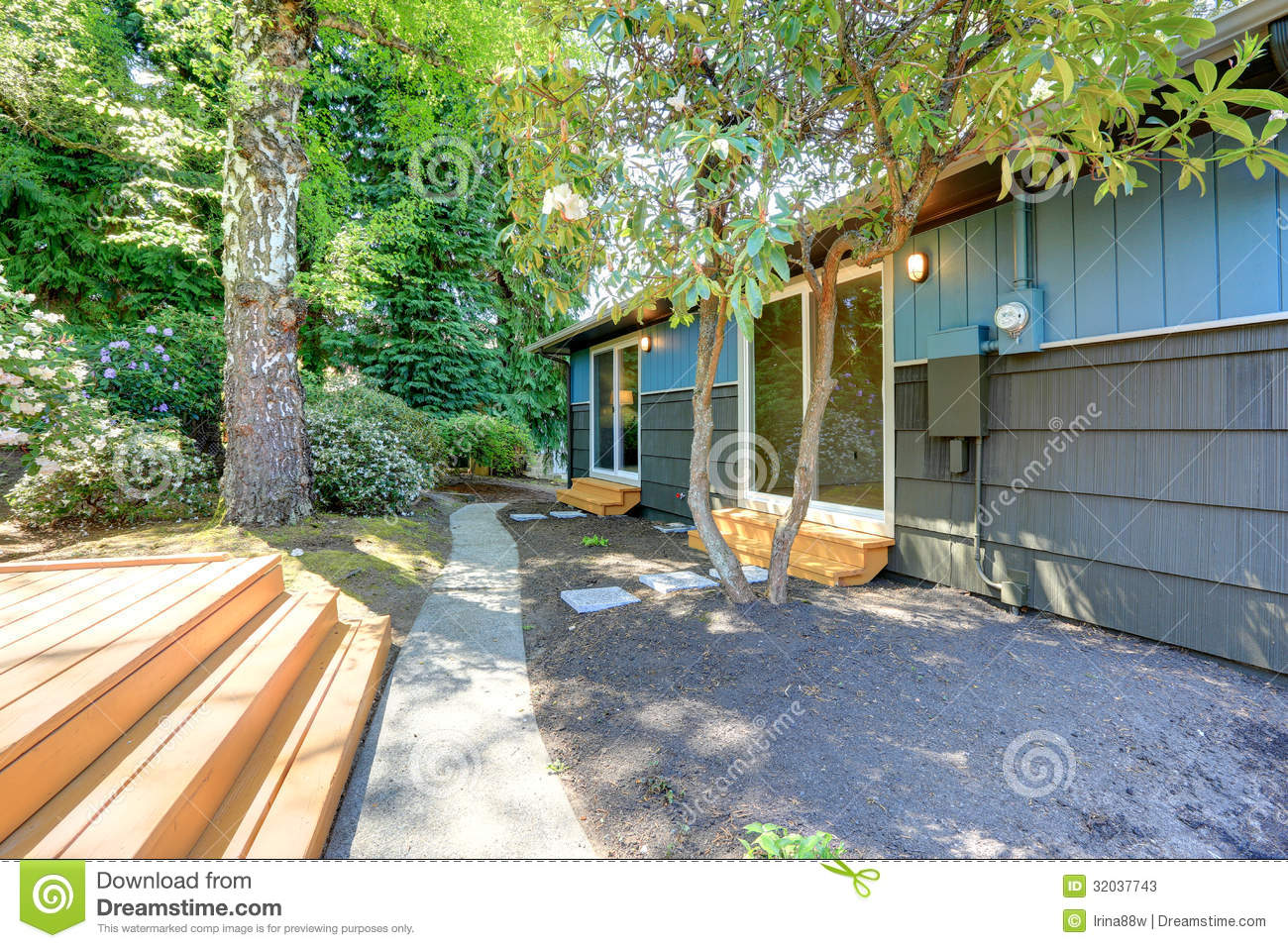 Small Blue House With Deck Of The Garden Studio And Birch Tree.