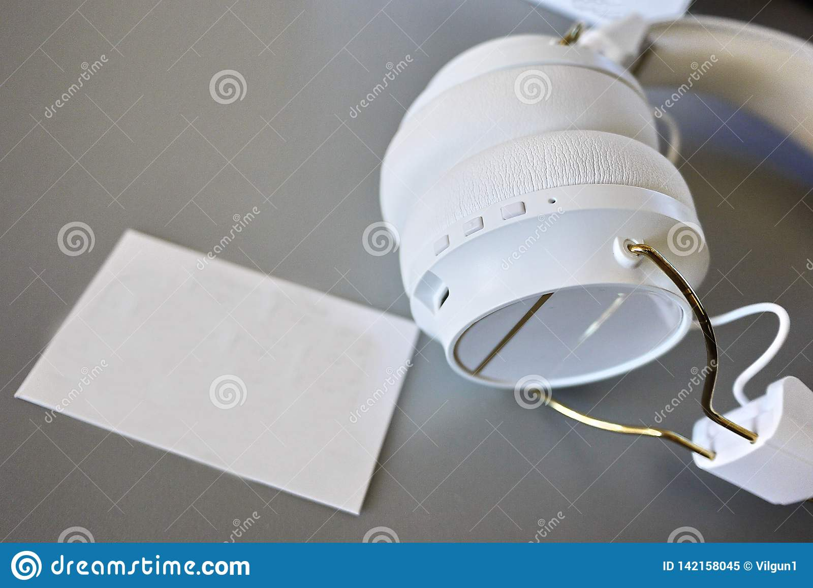 Small Bluetooth headphones, white color, close-up