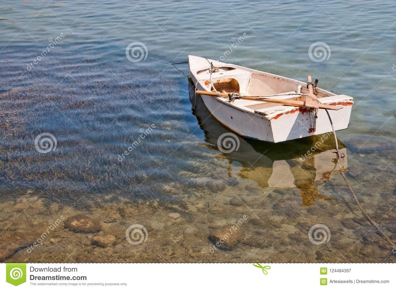 Small Boat Moored In Shallow Water With Protected Seagrass