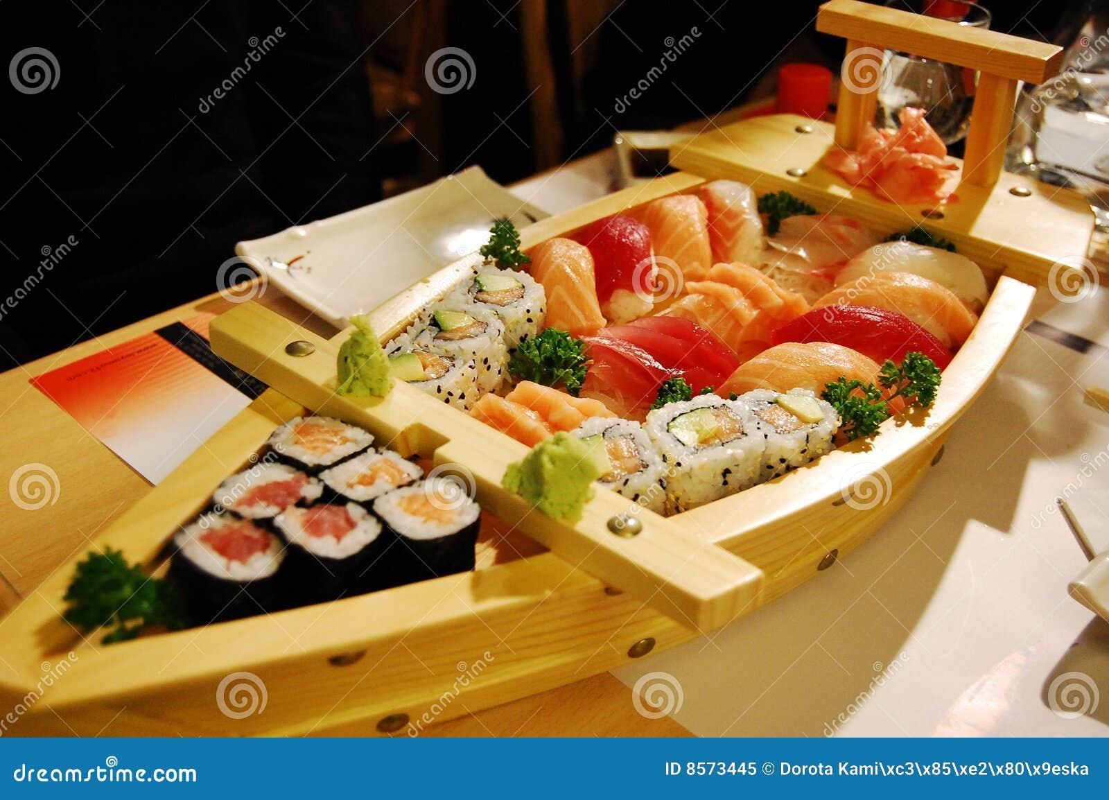 Small Boat With Sushi V3 Royalty Free Stock Photo - Image: 8573445