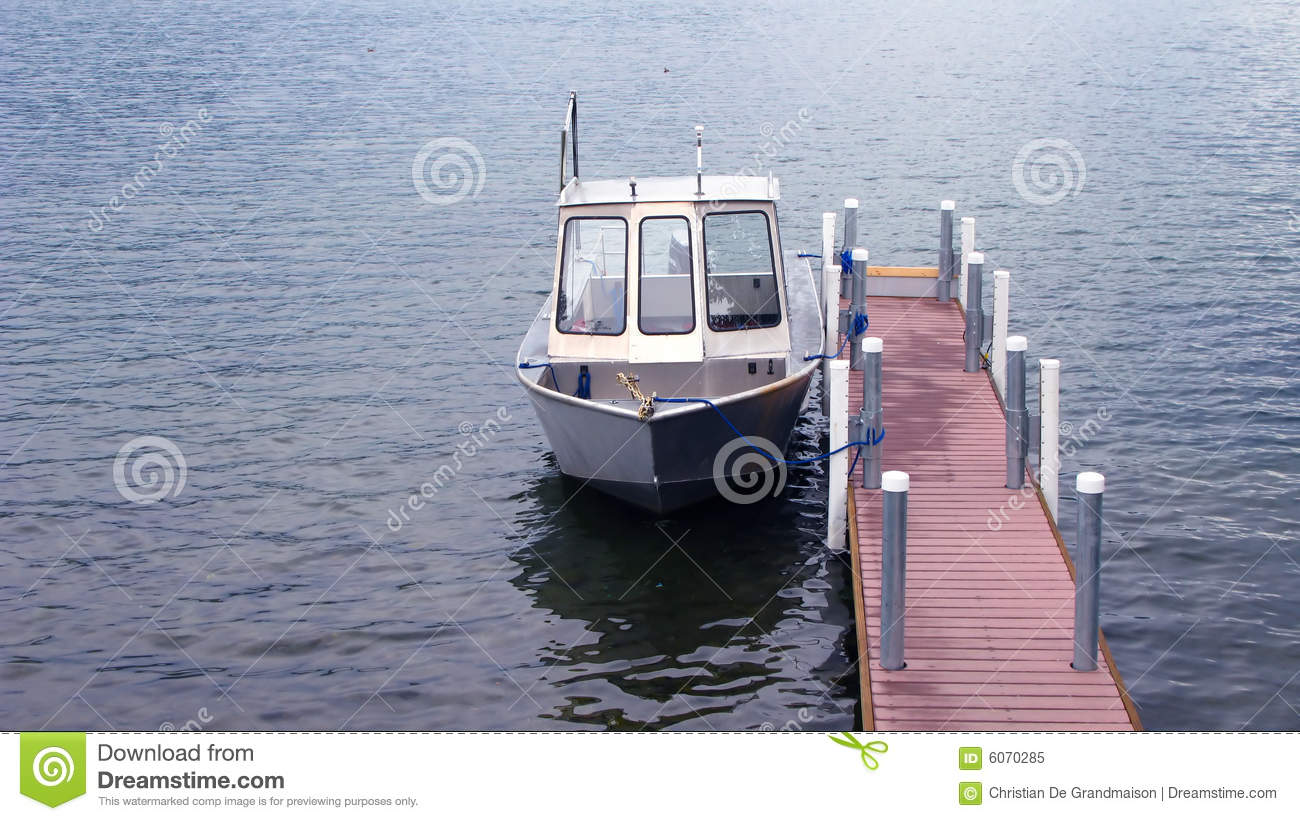 Small Boat Tied To Narrow Dock Stock Image - Image: 6070285