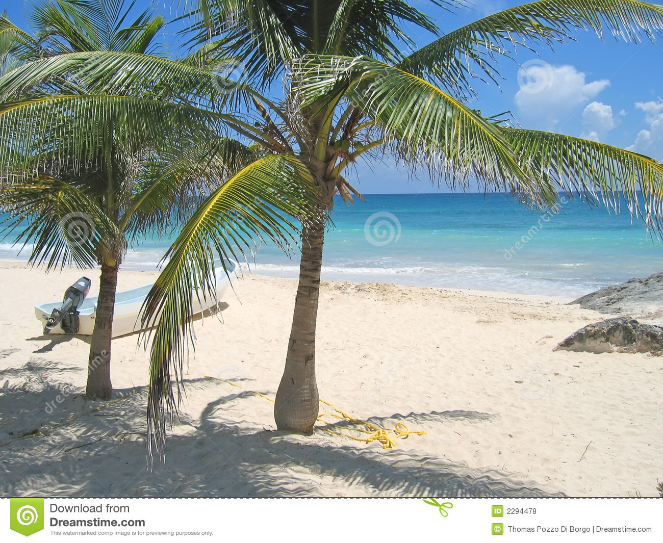 small boat on a tropical white beach and blue sea with palm tree ...