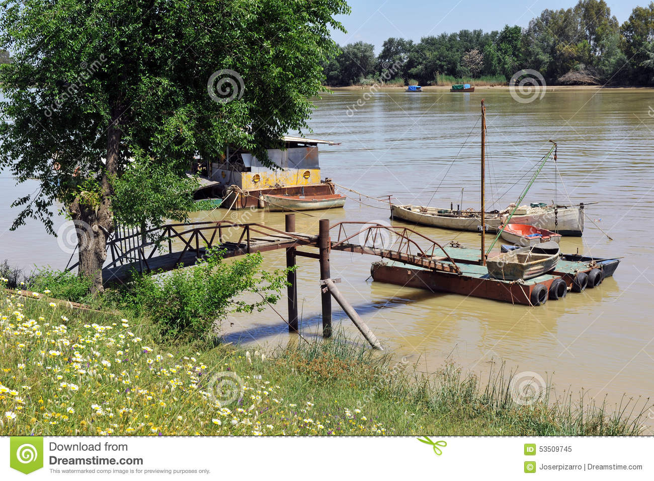 Small boats at the pier, the Guadalquivir River as it passes through Coria del Rio, Seville province, Andalusia, Spain