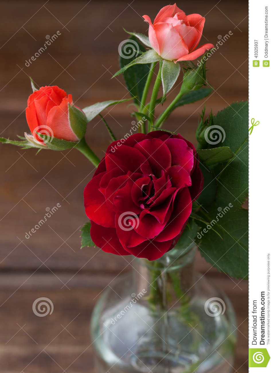 Small bouquet of roses on a wooden background stock image for Different color roses bouquet