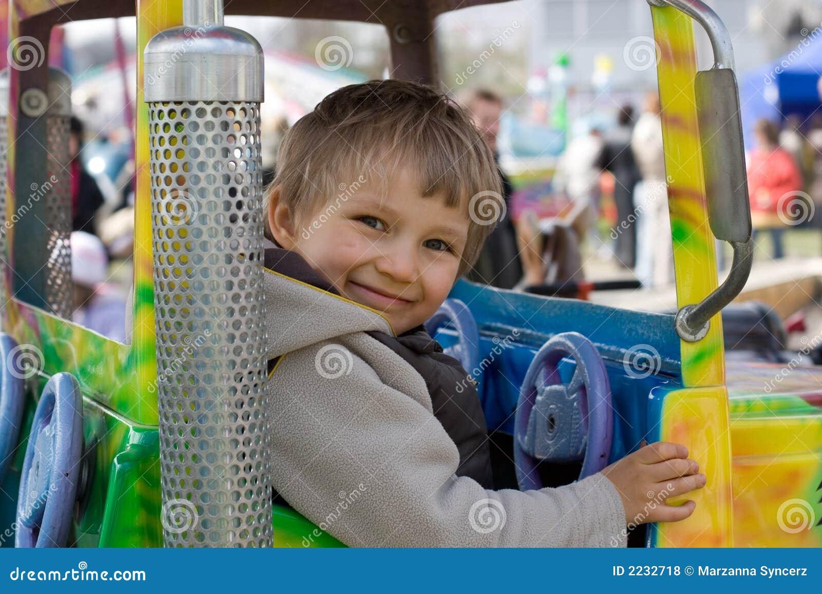 Small Boy on Amusement Ride
