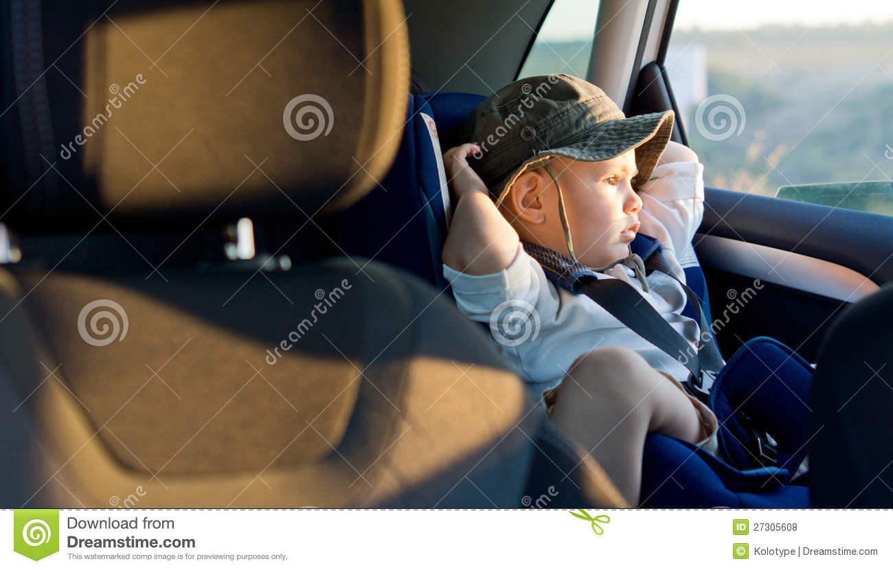 Small boy in child seat