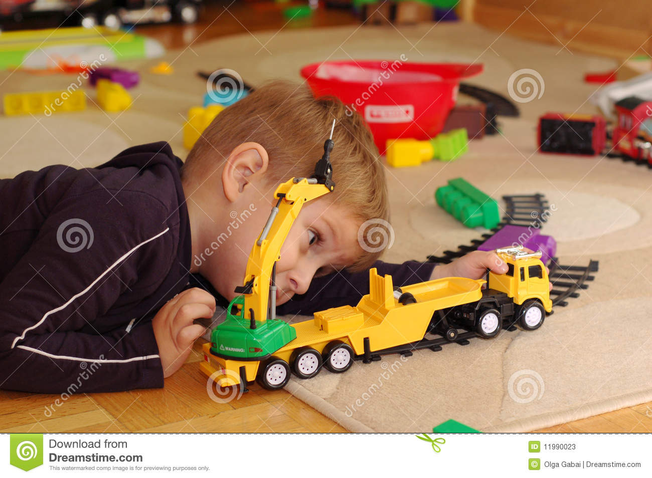 Toy Trucks For Boys : Small boy playing with toy truck stock image
