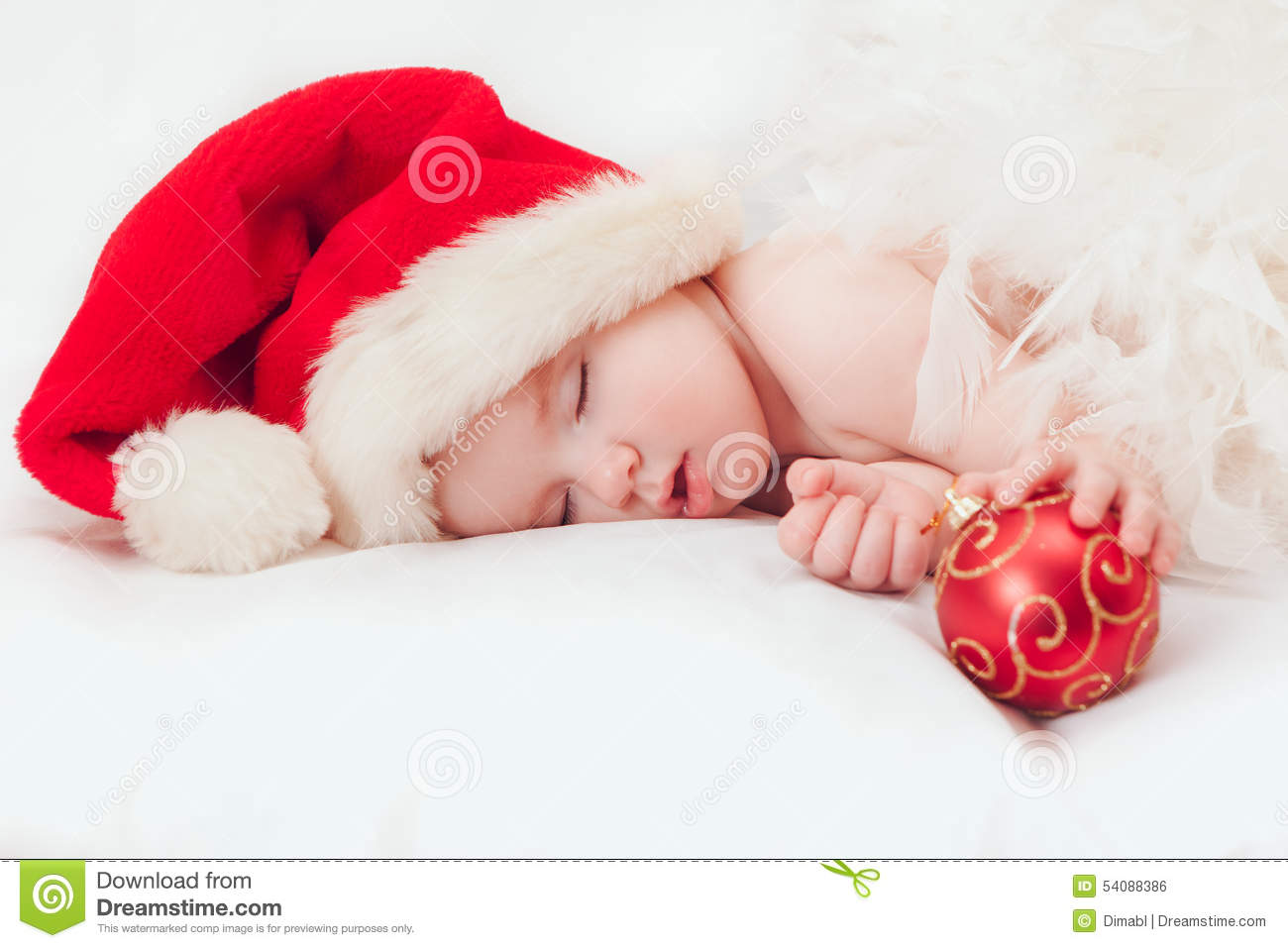 Sleeping baby Santa Claus red hat and holding Christmas tree decoration fbbec964c73