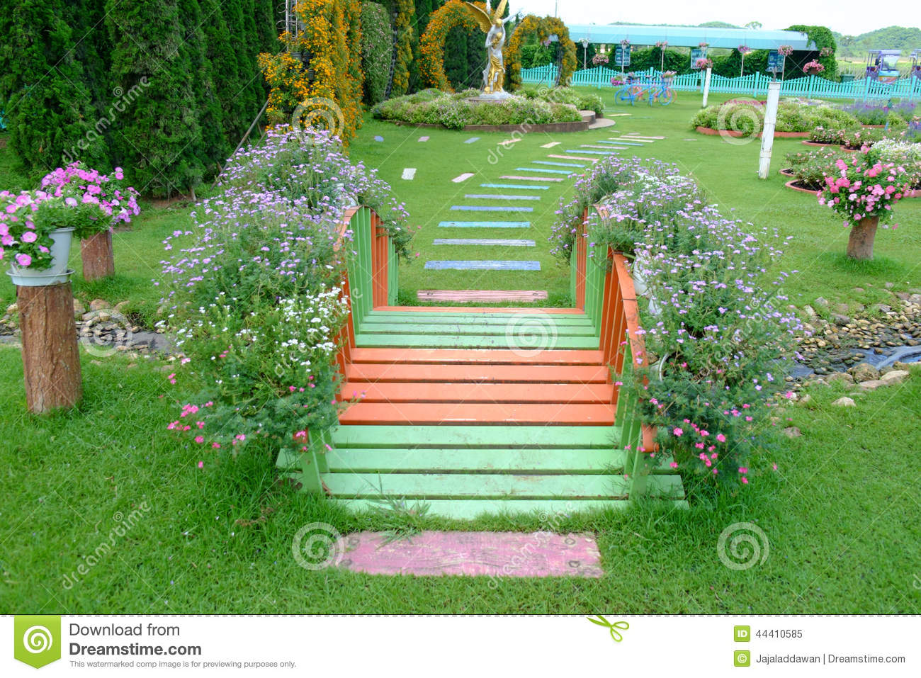 Small Bridge In A Flower Garden