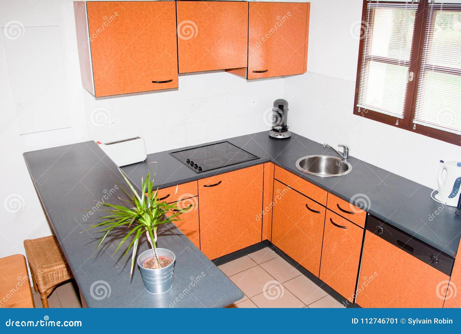 Small bright orange kitchen set in modern style vintage