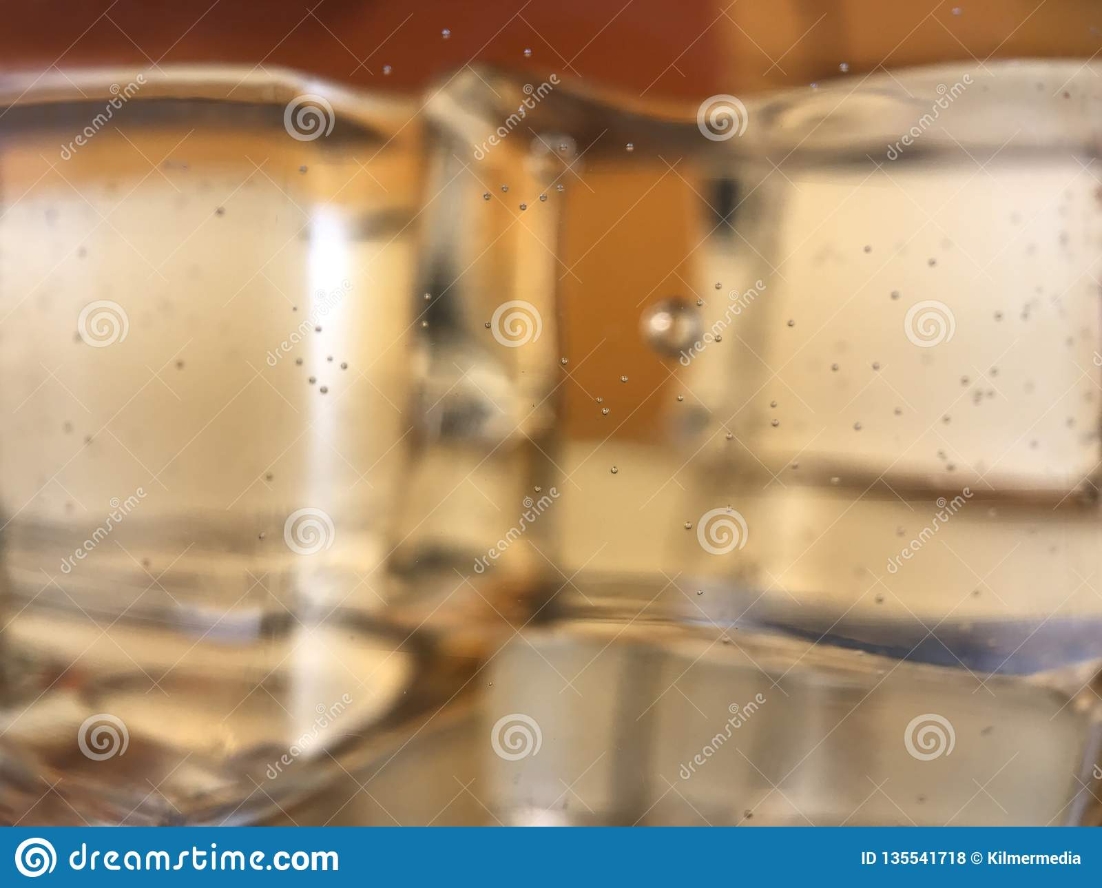 Small Bubbles On The Inside Of A Glass Filled With Whiskey