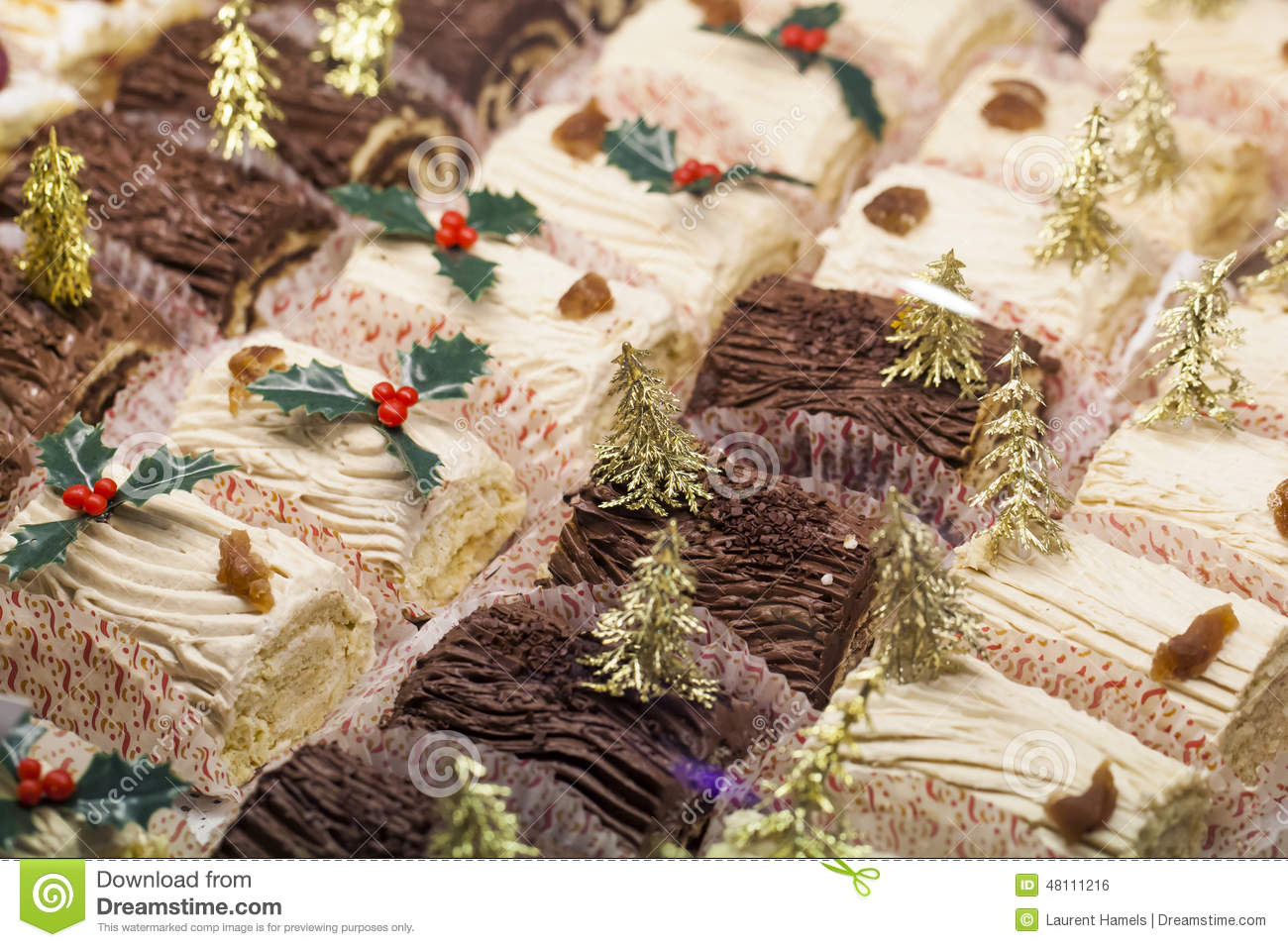 small buches de no 235 l with gold decorations at pastry shop stock photo image 48111216