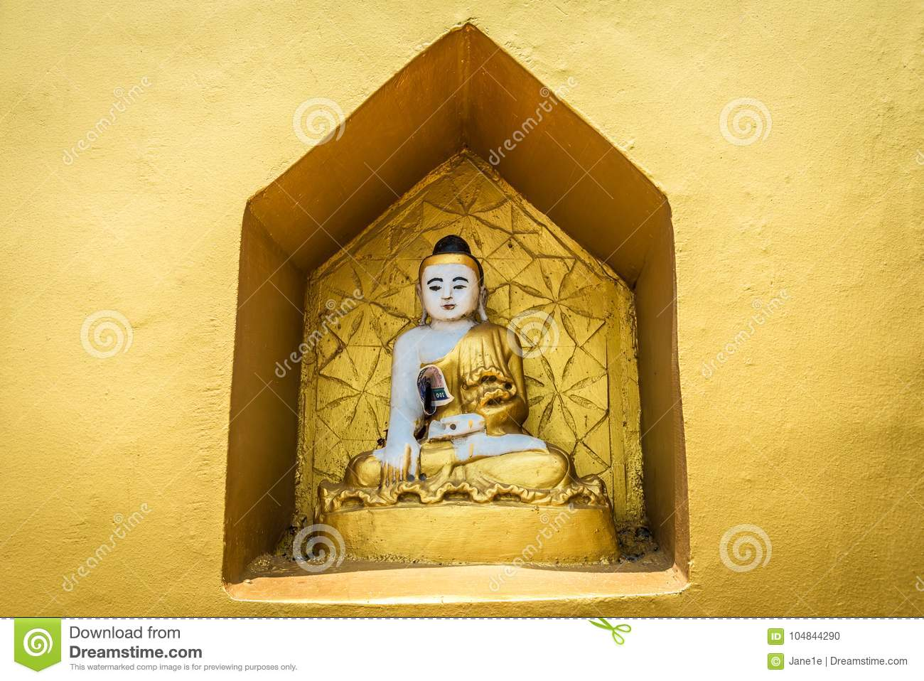 A small Buddhist altar with Buddha statues.