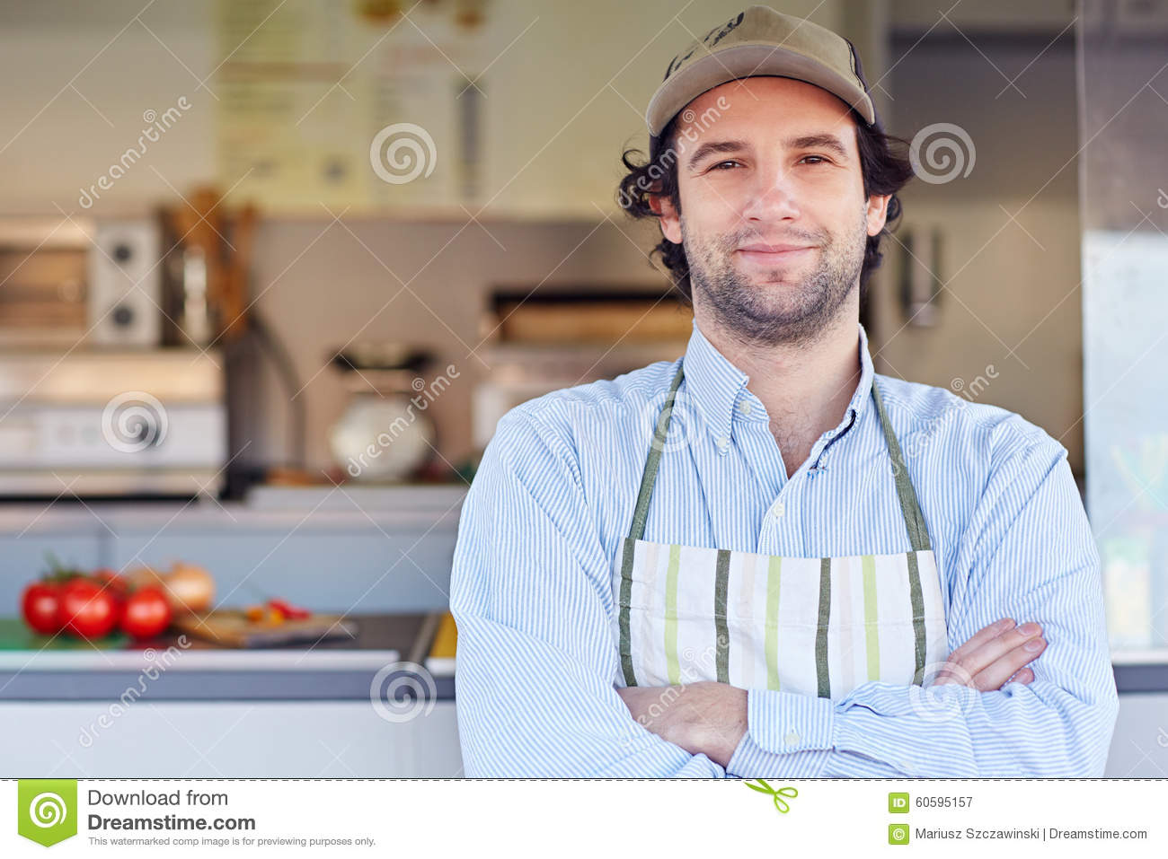 Small business owner smiling in front of his takeaway food busin