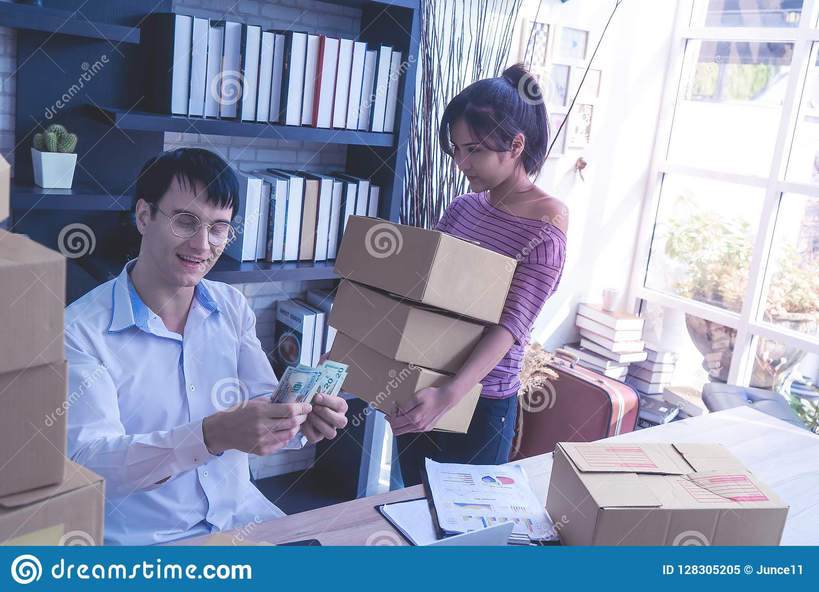 Small Business team checking stock in her online home busines