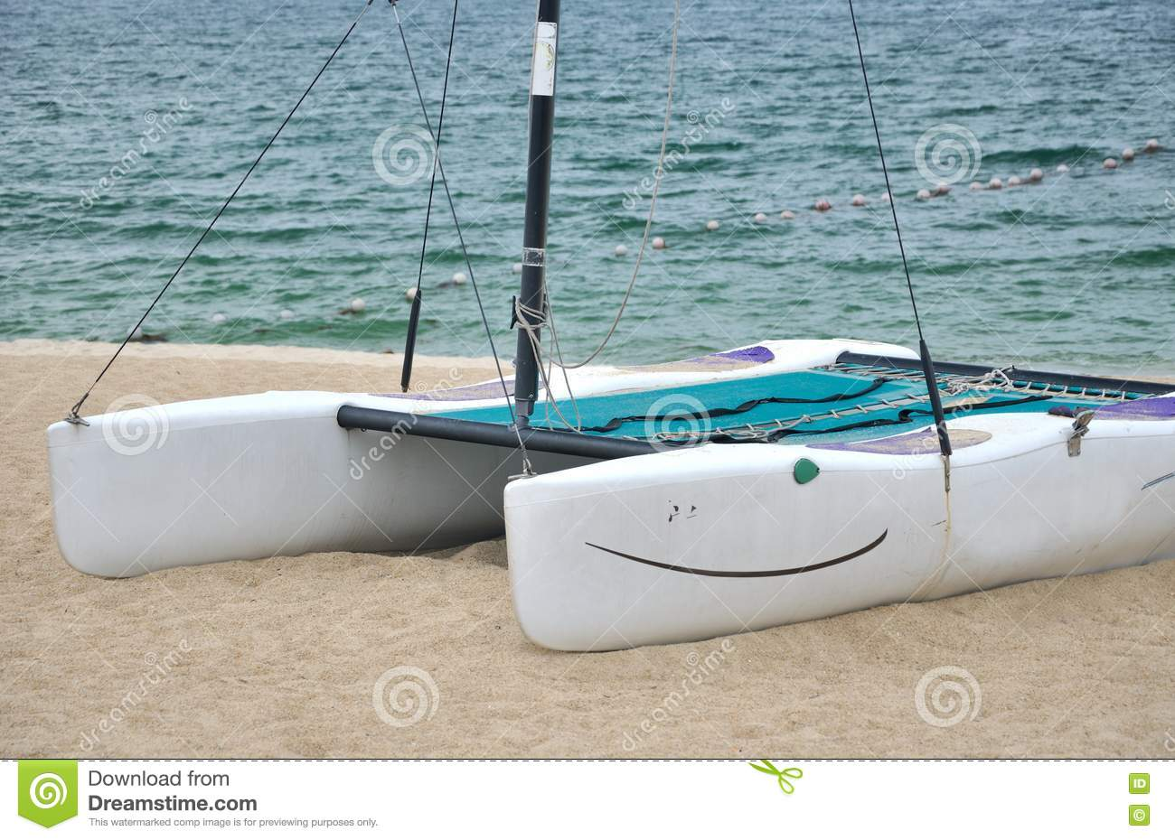 Small catamaran on beach sand stock image image of sand for Small catamaran fishing boats