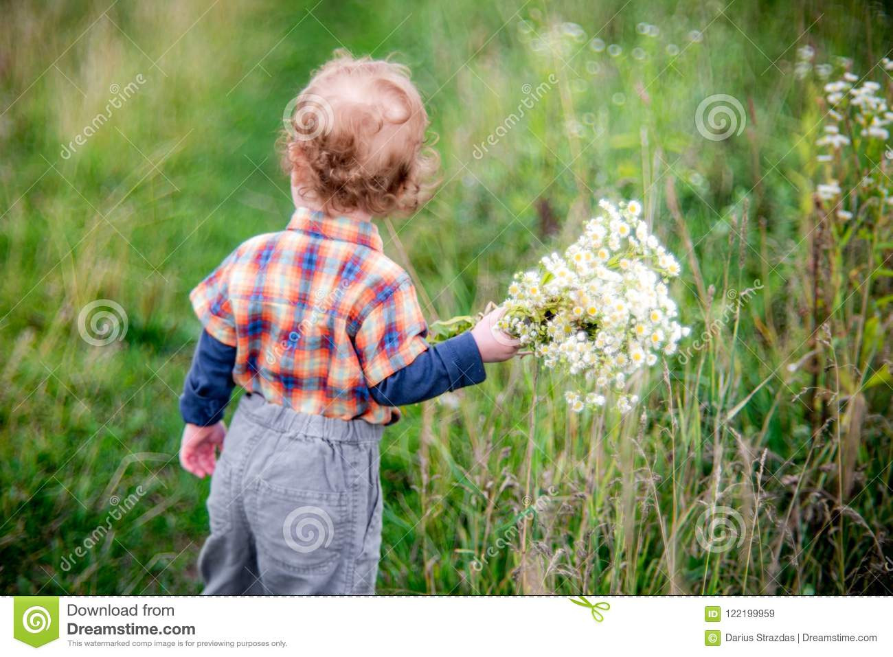 Small child boy with flowers