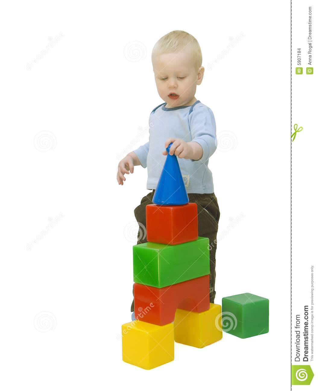 The Small Child Building A Tower From Cubes Stock Images