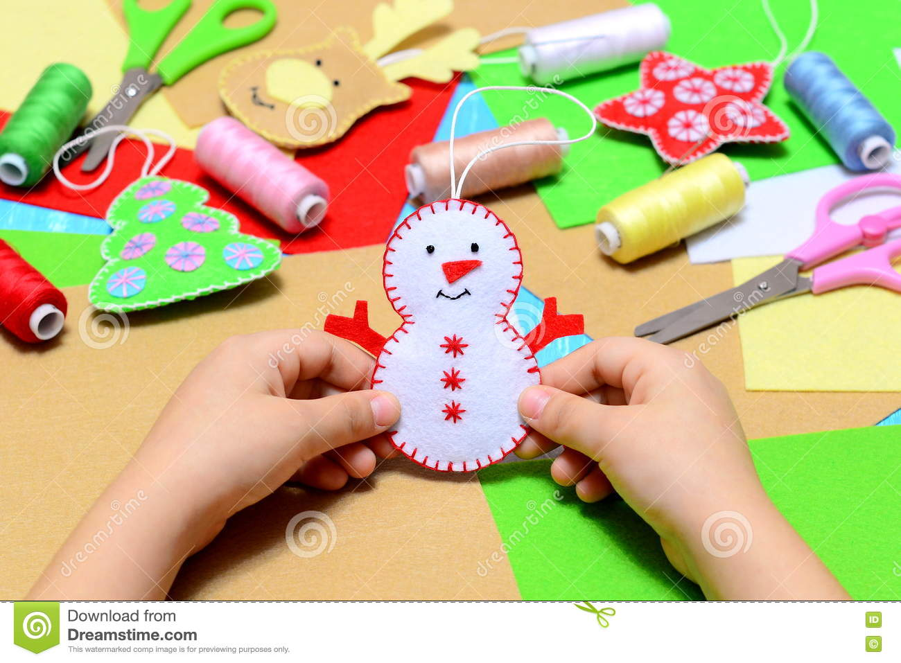Small Child Holding A Felt Christmas Snowman In Hands. Little Kid ...
