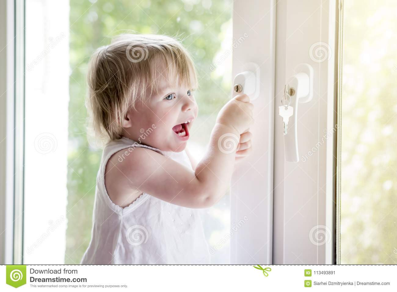 Small child near window. lock on handle of window. Child`s safet