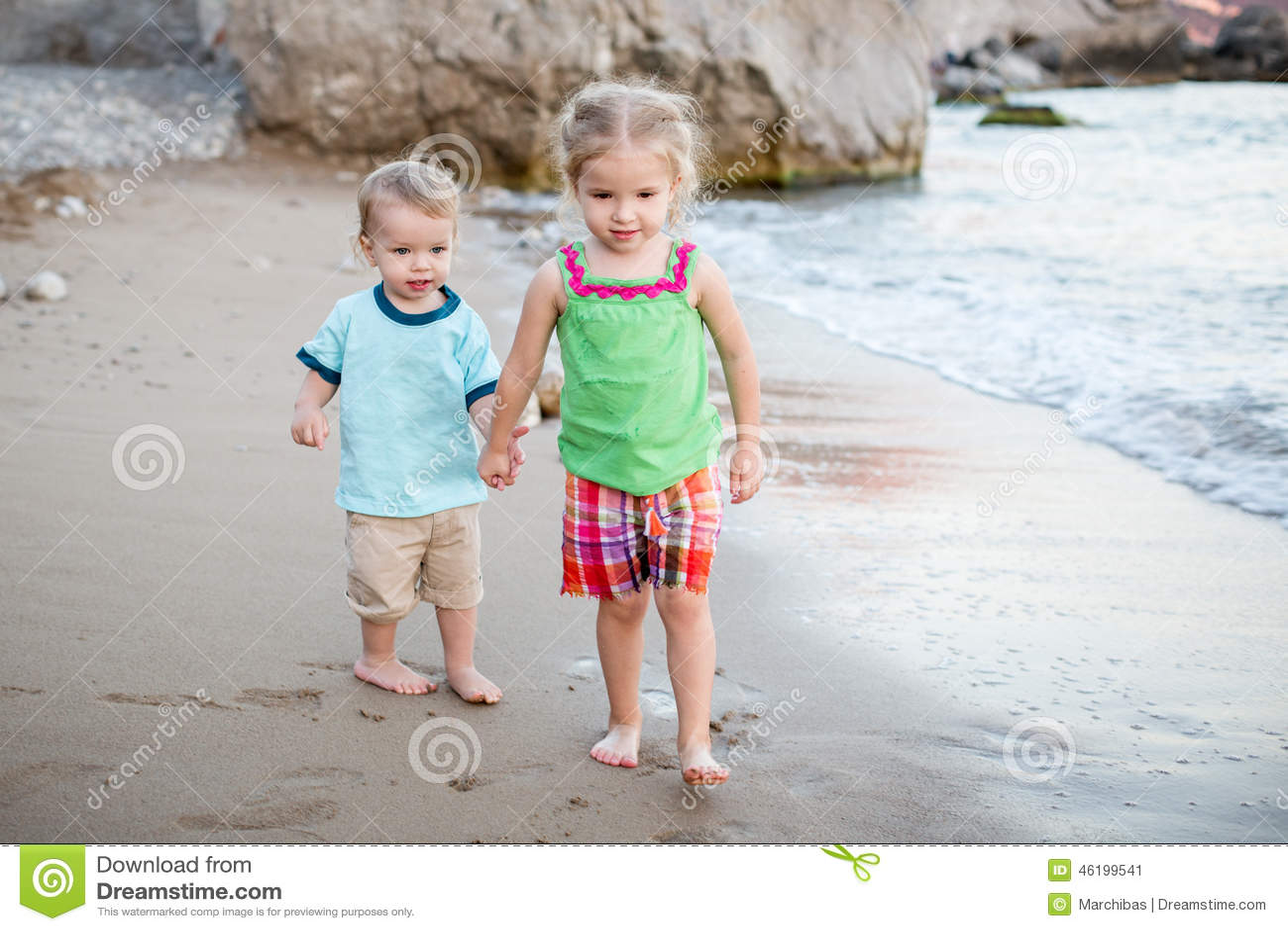 small-children-brother-sister-beach-walk