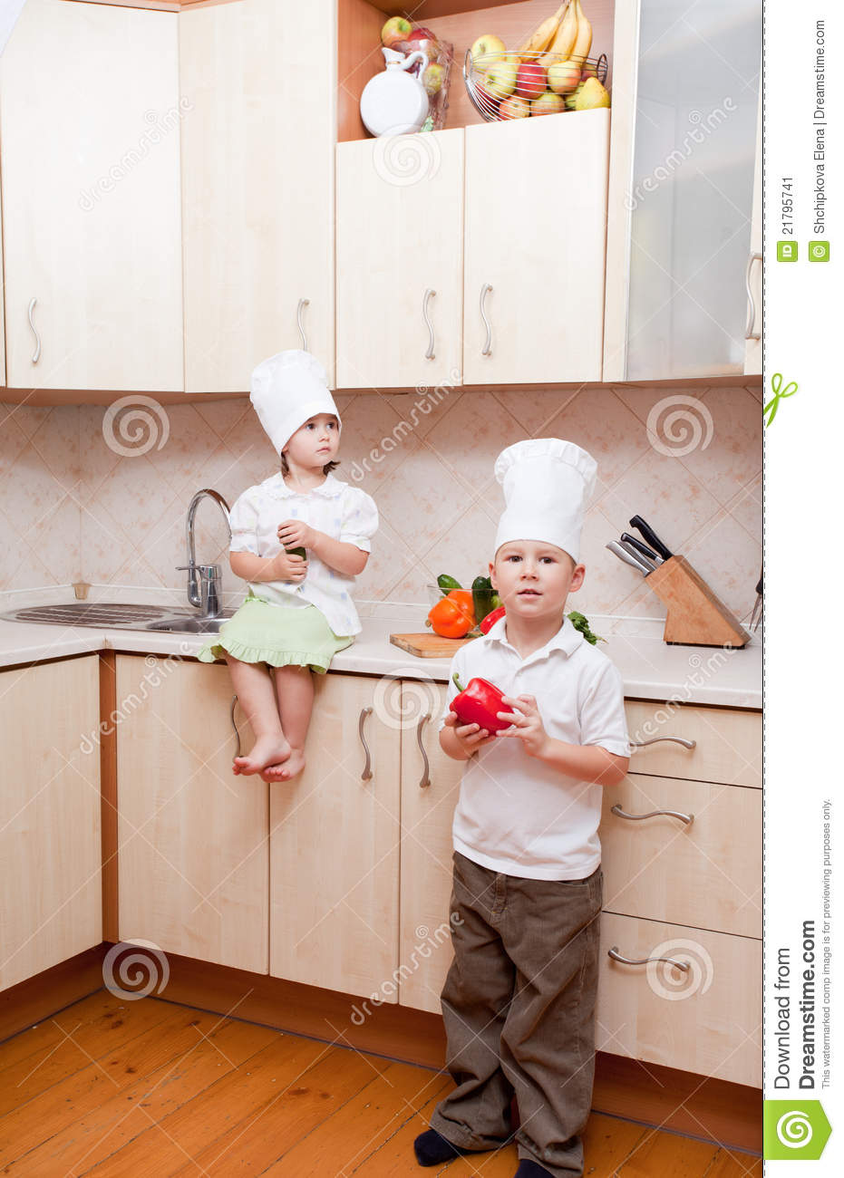 Small children on kitchen stock image image 21795741 for Small childrens kitchen