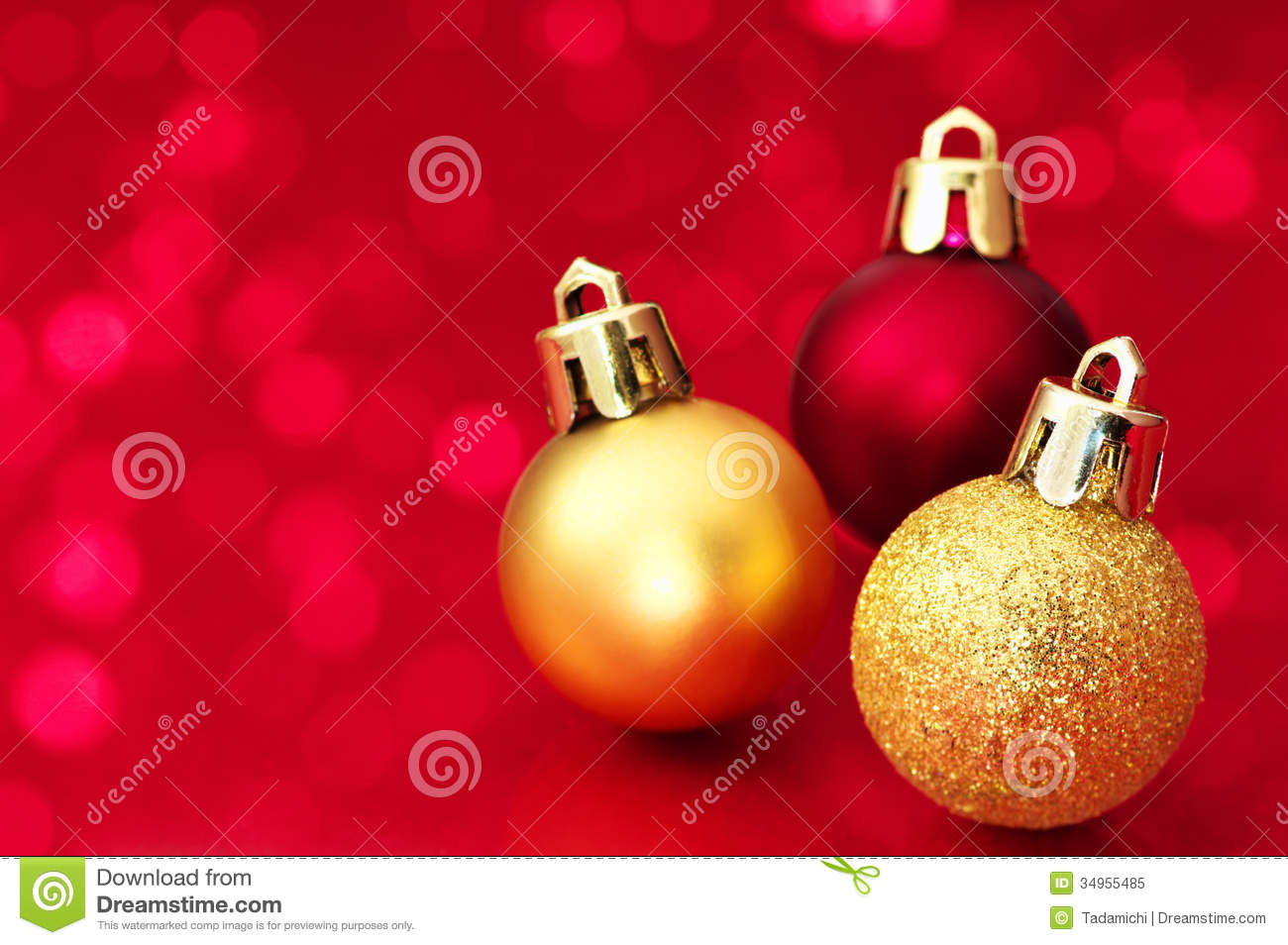 Small christmas balls on red sparkle background stock