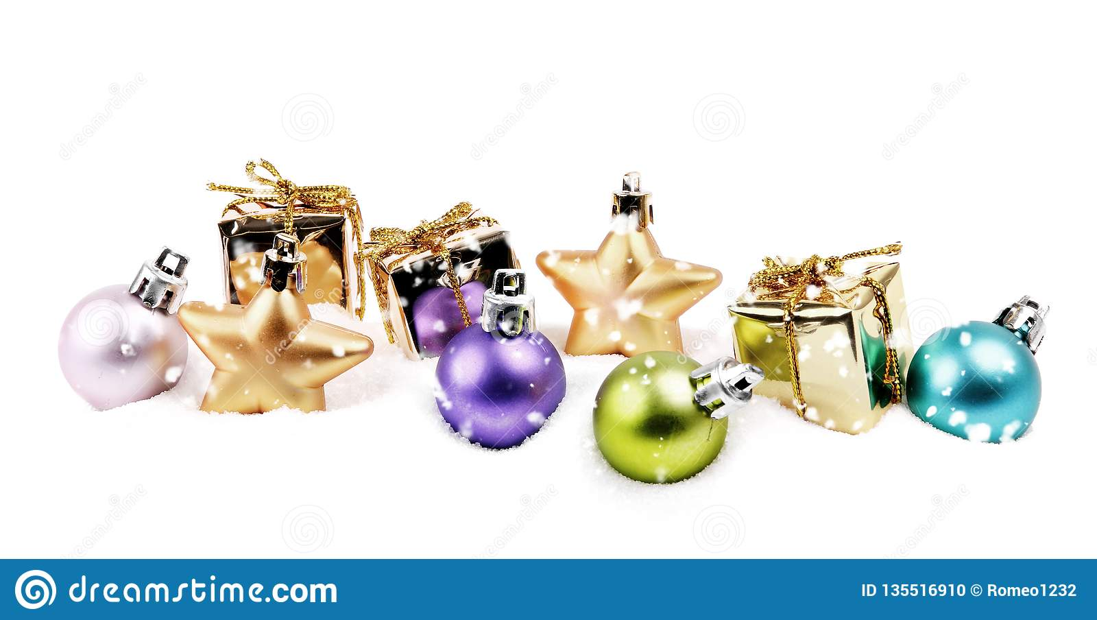 Small Christmas decoration items in snow