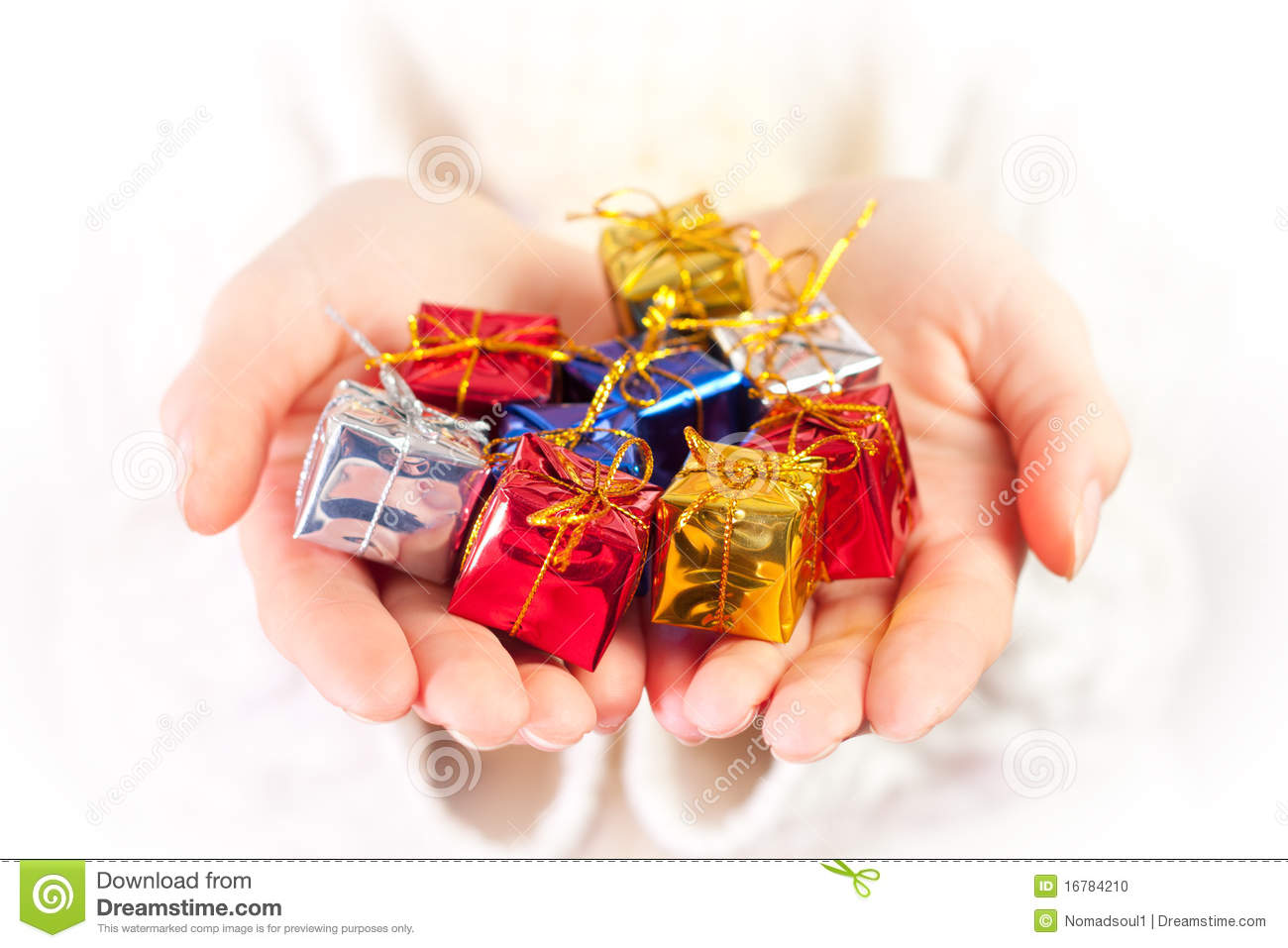 Small christmas gifts in palms of hands stock photo for Small christmas ideas