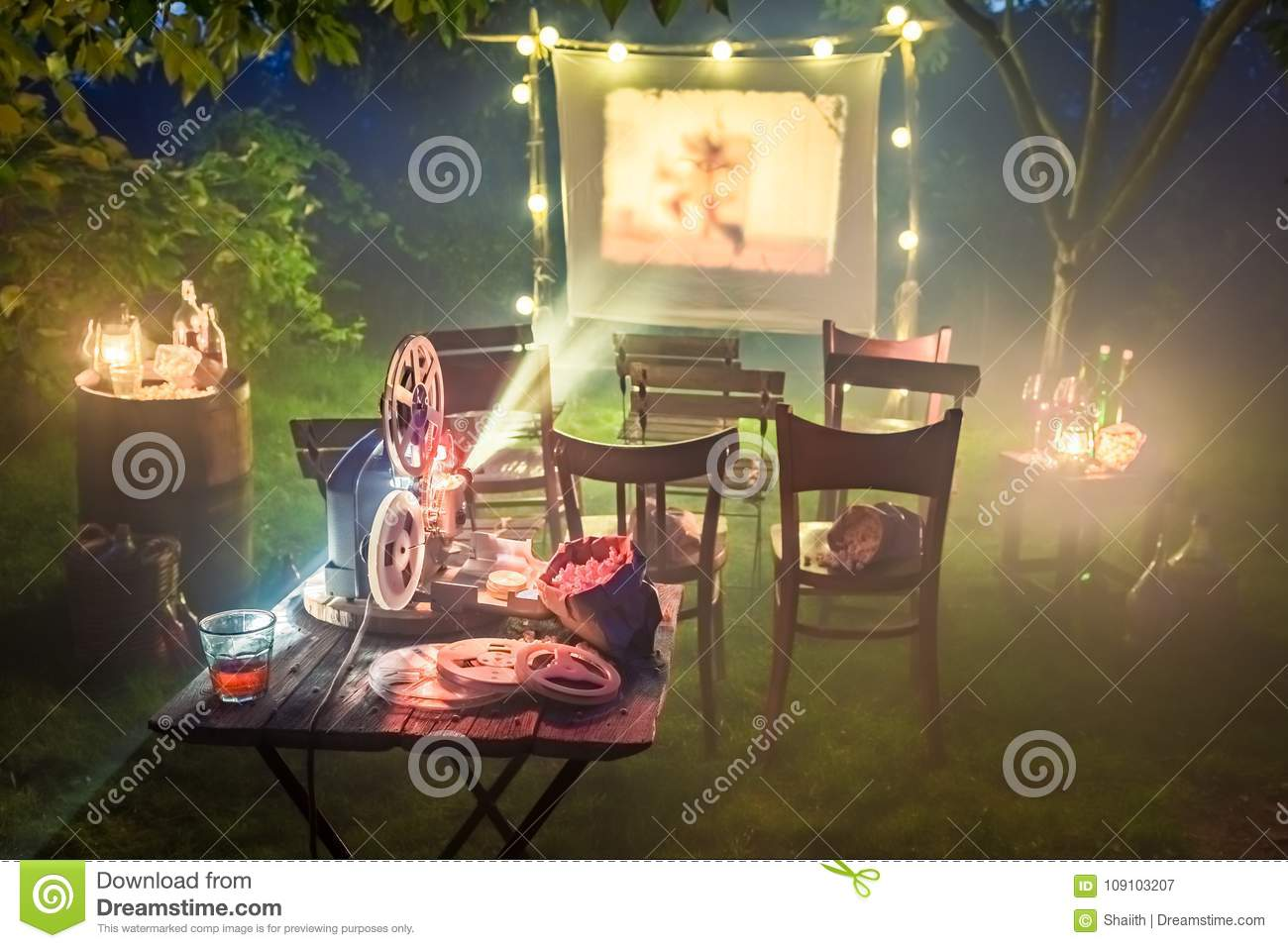 Small cinema with retro projector in the garden