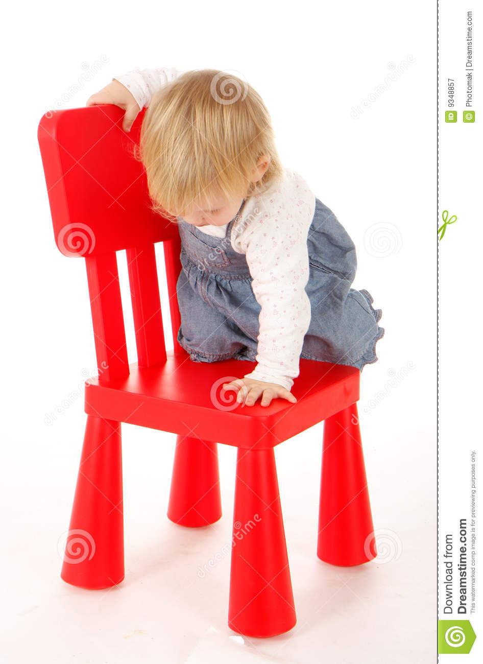 Small Climbing On Red Chair Young Girl Stock Image Image