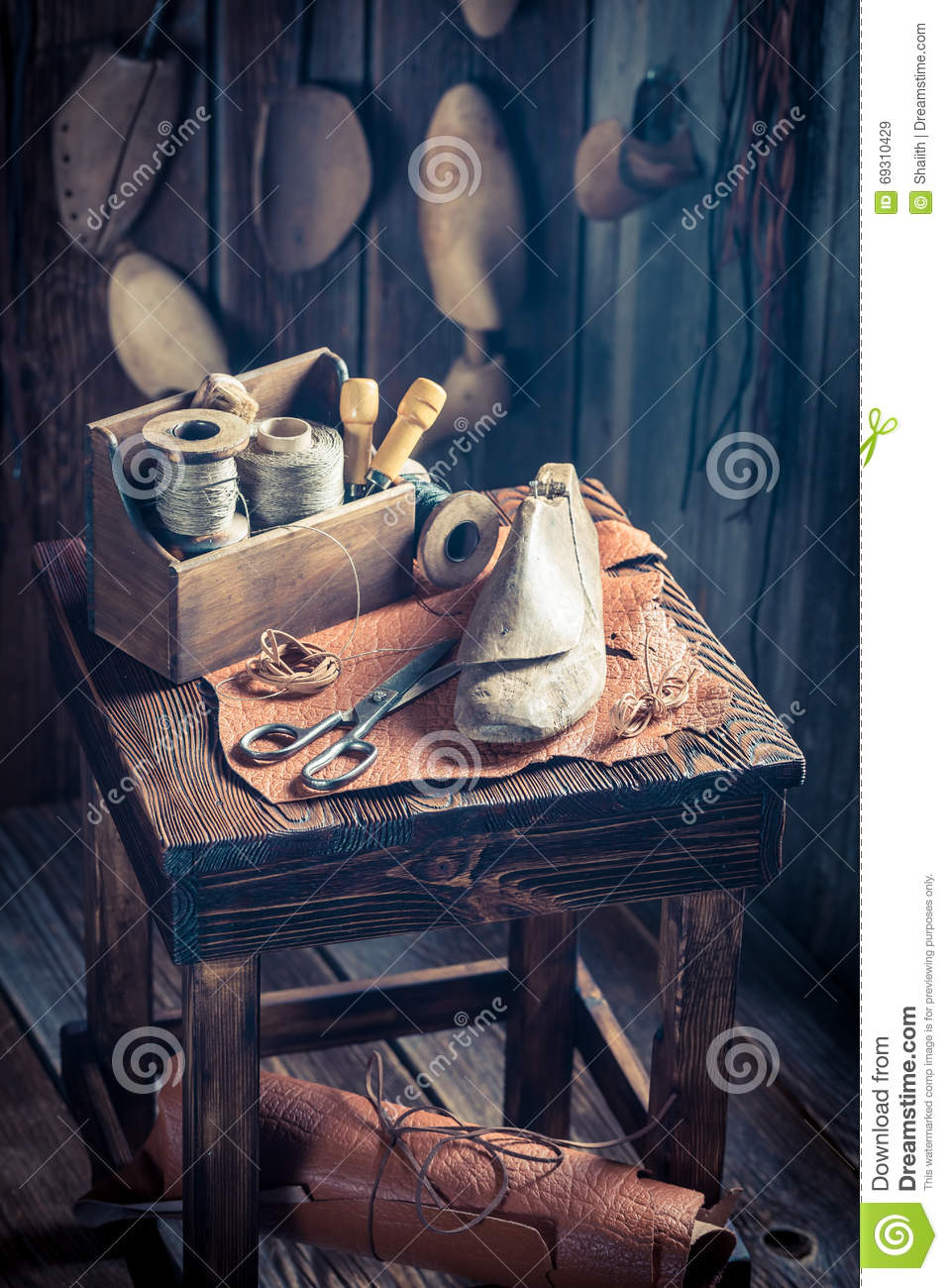 Small cobbler workshop with shoes, laces and tools