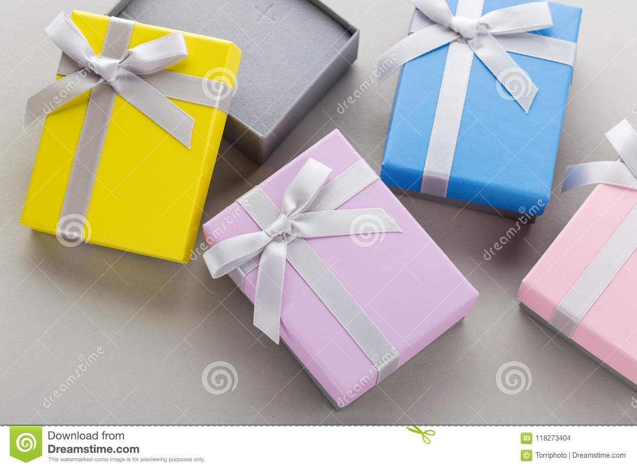 Small Colorful Jewelry Gift Boxes With Bows On Gray Background Stock