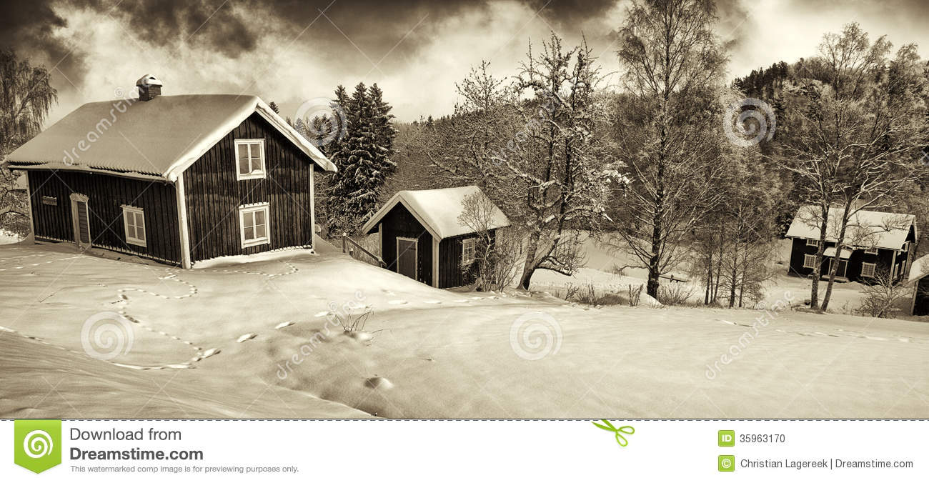 Small cottages in old rural winter landscape