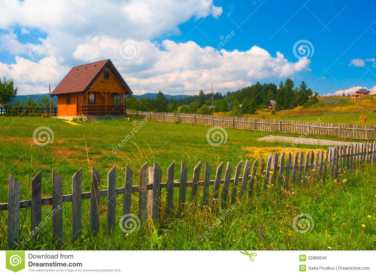 Small country house meadow and wooden fence stock image for Meadow house