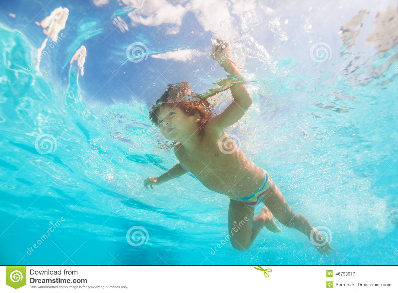 Small cute boy moving while swimming underwater stock for Cute pool pictures
