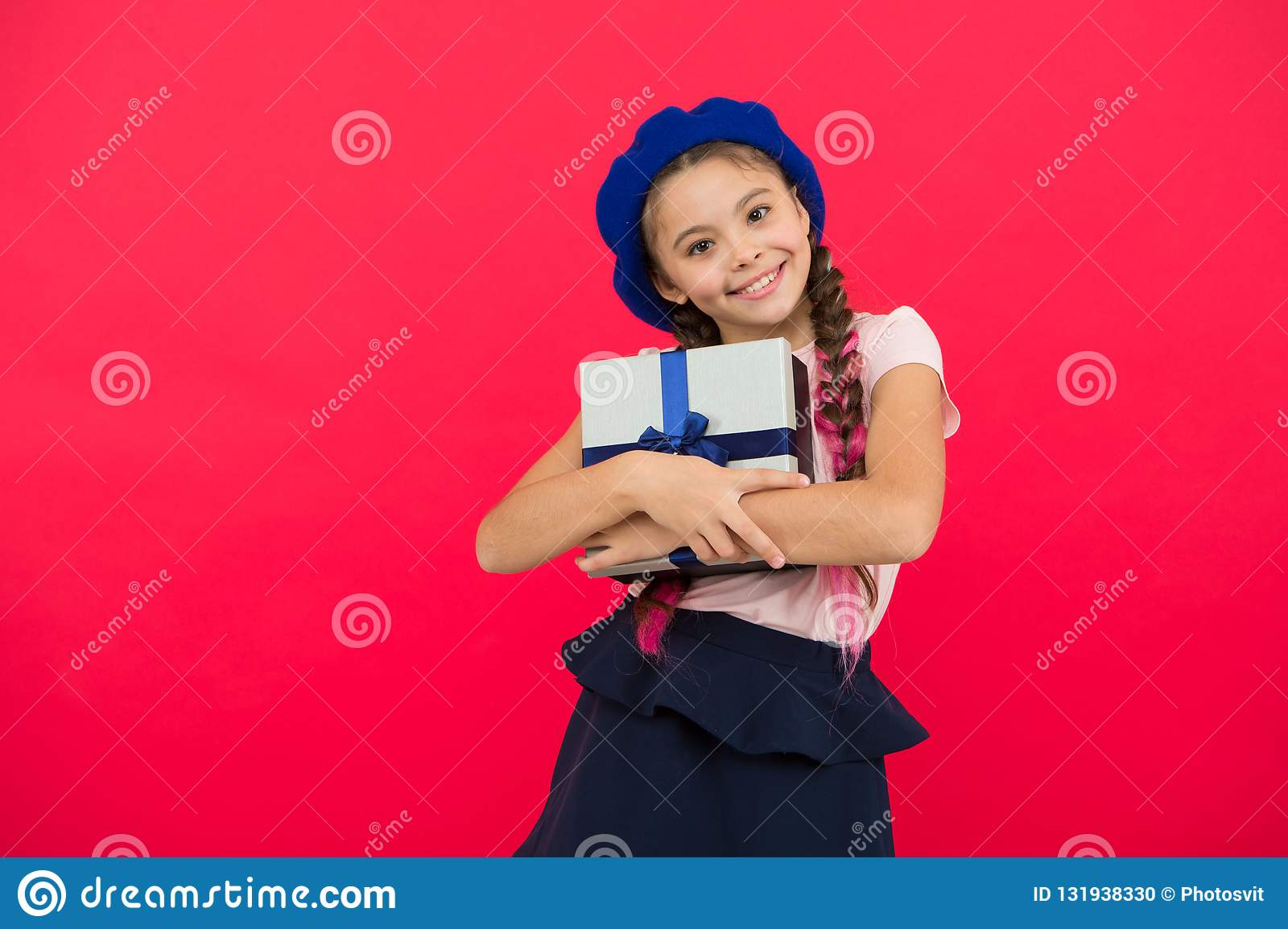 small cute girl received gift pack with ribbon bow guess what your child dream about