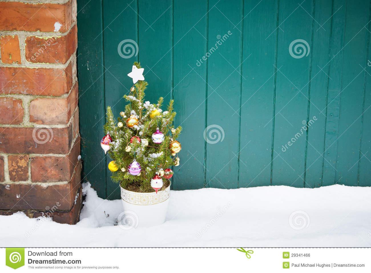 Royalty Free Stock Image: Small decorated christmas tree abandoned