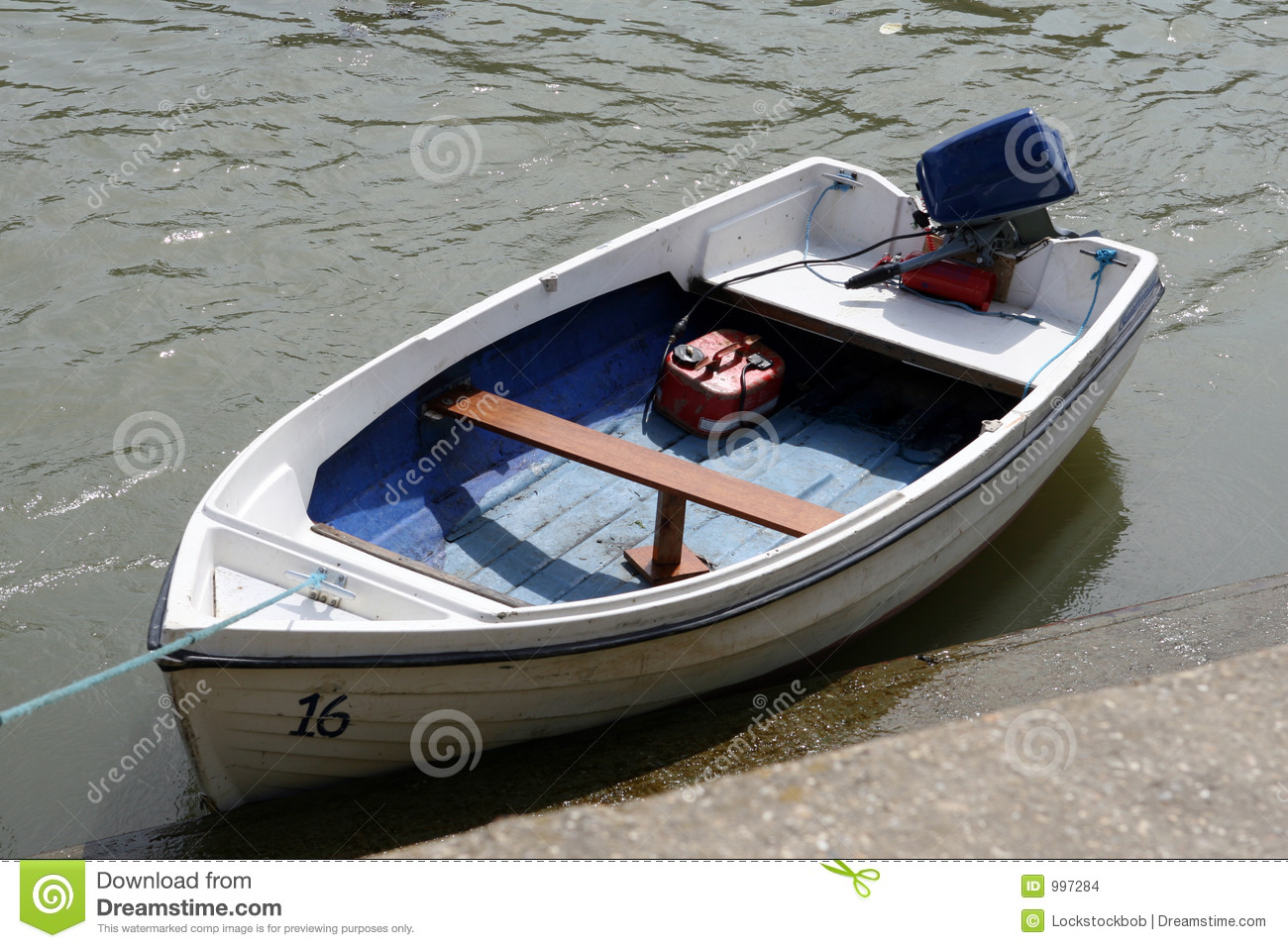 A small dinghy boat on a tidal sea river stock photo for Small motor boat cost