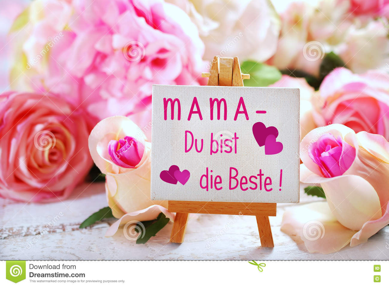 Small Easel With Greetings For Mom Written In German On The Boar