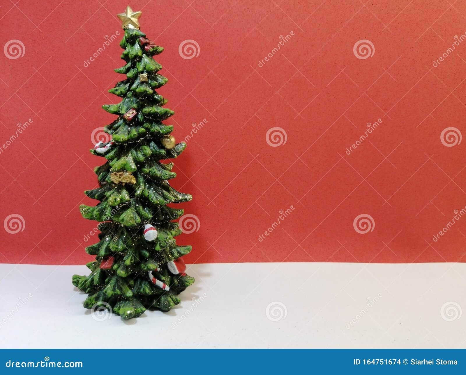 Small Elegant Christmas Tree On Red Background Stock Photo Image Of Festive Interior 164751674