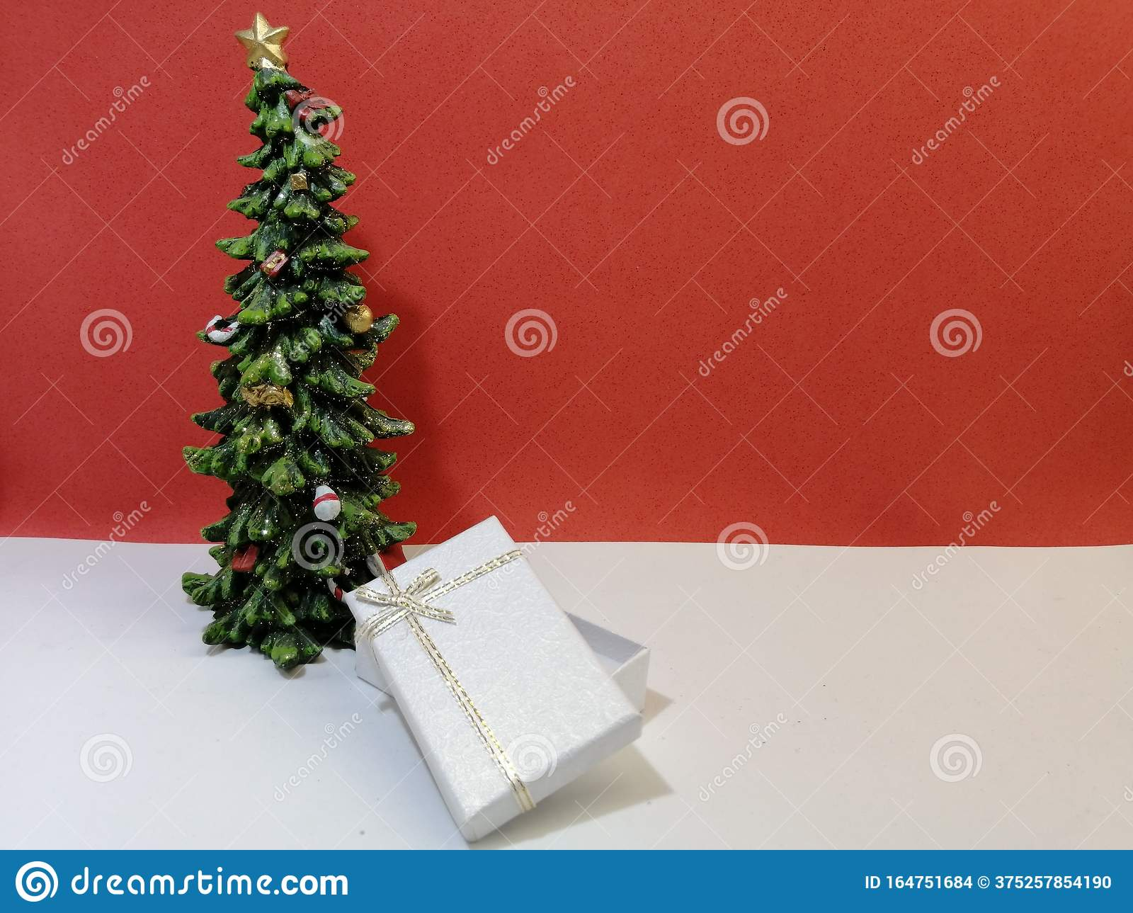 Small Elegant Christmas Tree With A White Ajar Gift Box Stock Photo Image Of Gift Evergreen 164751684